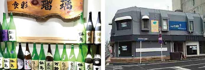 入り口には一枚板の看板と日本酒の瓶が! 店は佐賀市役所西向いのビル、1Fにあります